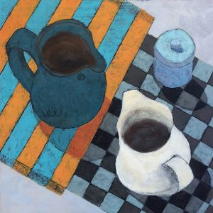 Green jug on striped cloth and white jug on chequerboard cloth with small blue container