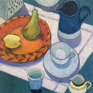 Orange fruit bowl with teacup and saucer and blue jug