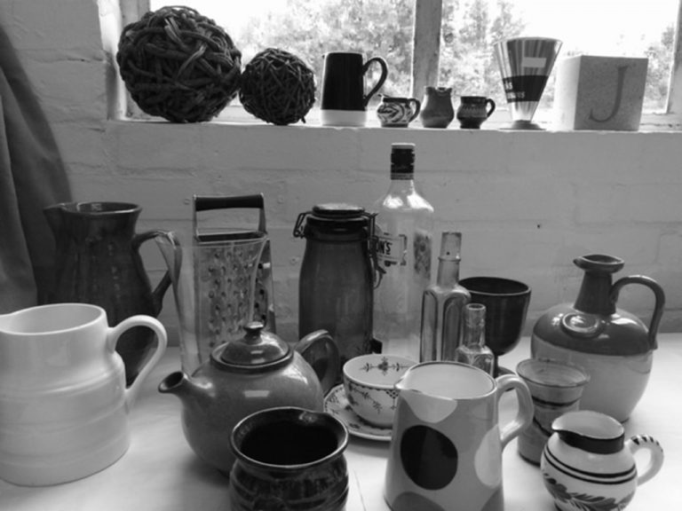 Studios Windowsill and table with jugs and containers